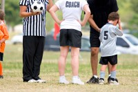 Coach and parents arguing with officials