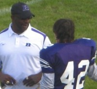 Football athlete speaking with youth coach