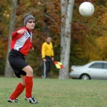 Soccer player poised to strike