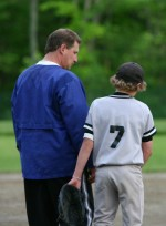 Parent speaking to youth athlete
