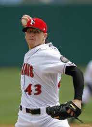 College baseball player pitching